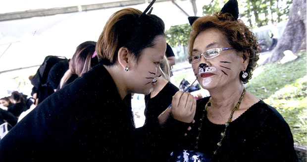 Largest gathering of people dressed as cats makeup