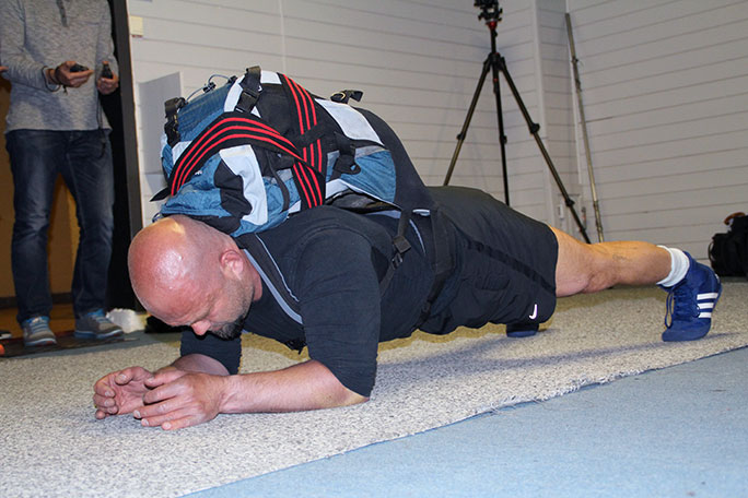 Longest time in an abdominal plank position with a 200-lb pack