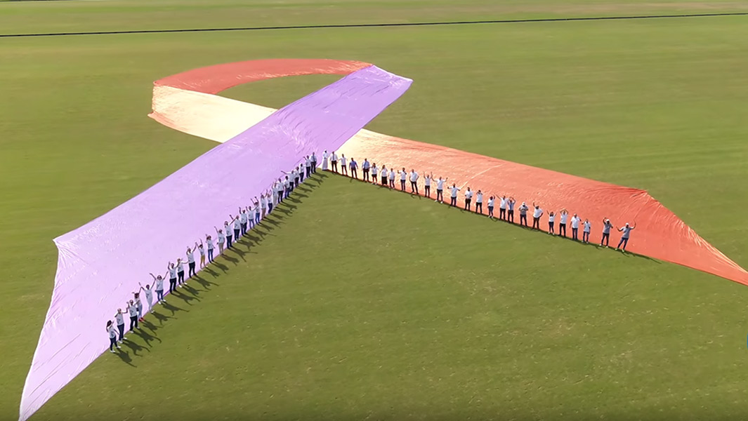 Largest awareness ribbon header with people guinness world records World Psoriasis Day leo pharma