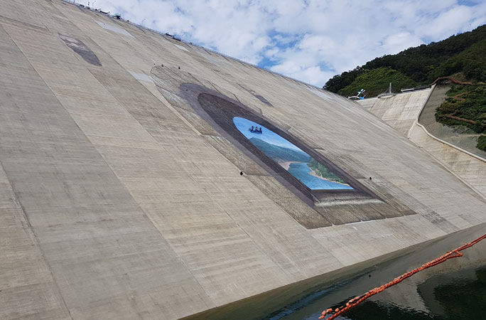 dam being painted