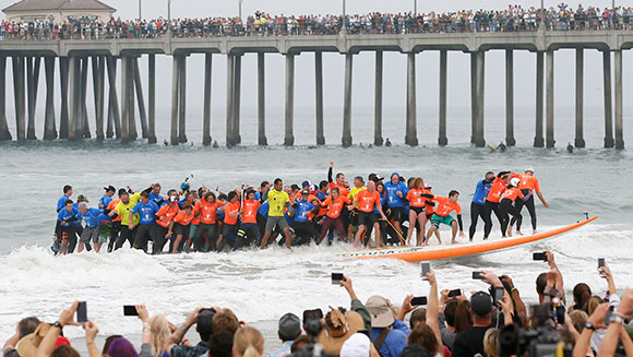 most people riding a surfboard - spectators