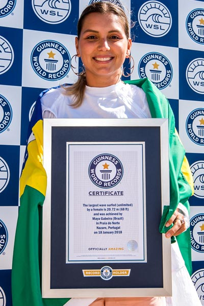Maya with her certificate for her previous record set in 2018
