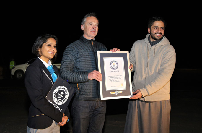 The Royal Commission for AlUla celebrating achieving the longest hot air balloon glow show