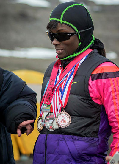 fastest-time-to-fun-a-marathon-on-each-continent-wearing-medals