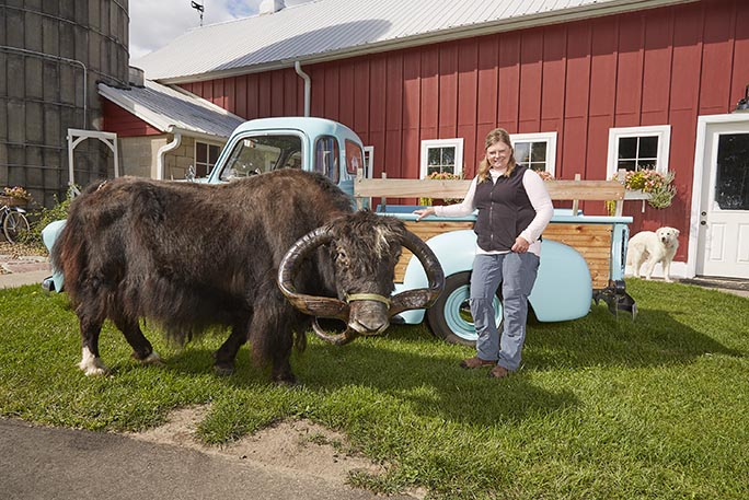 jericho-the-yak-with-owner-melodee-smith-in-front-of-barn
